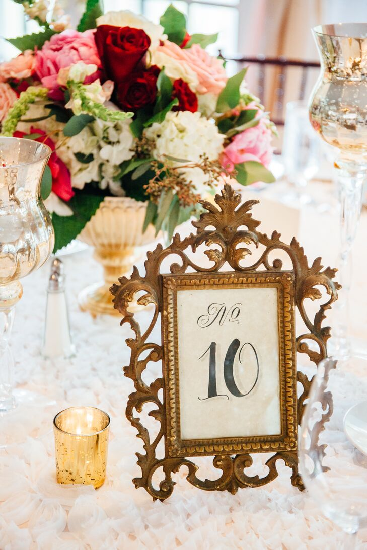 Heightening the evening's sense of old-world elegance, Jamila and Dennis placed each table number in elaborate vintage frames. Styled alongside mercury glass accents, textured table linens and bountiful bouquets of roses and hydrangeas piled high atop footed vases, the subtle detail effortlessly brought the couple's vision to life.