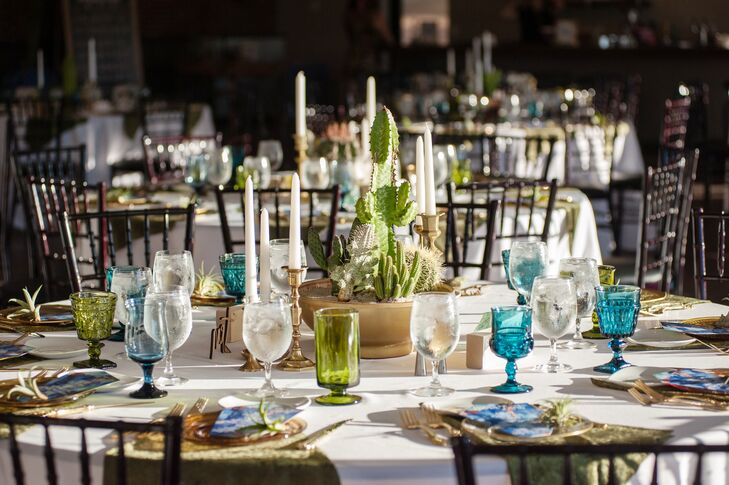 Colorful vintage glassware matched the day's green and blue palette and matched the cactus centerpieces.