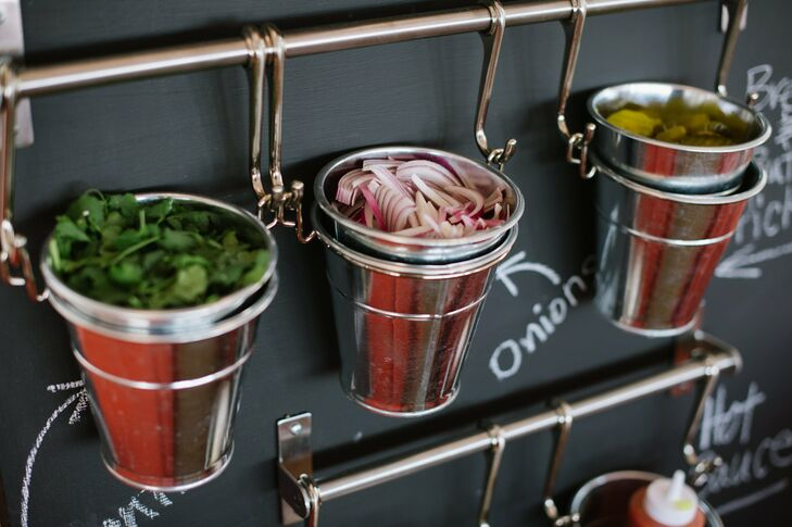 Condiments like sliced onion and chopped cilantro were waiting in a fun bucket and chalkboard display next to the barbecue station.
