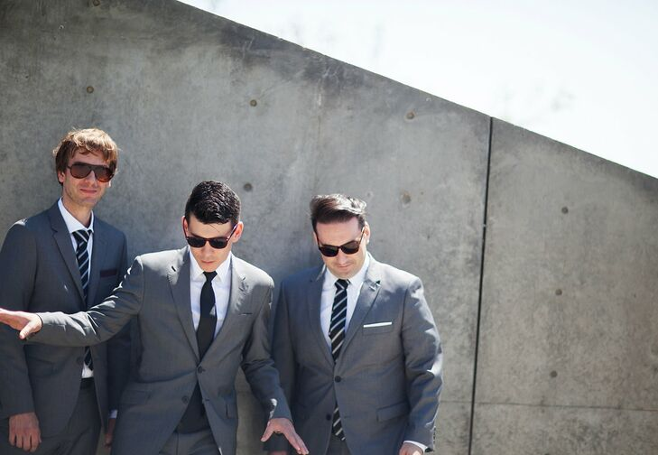 Like Danielle, David took his wedding day look in a more modern direction, selecting a sleek gray suit by Topman and black tie for his walk down the aisle. His two groomsmen donned similar styles, which they accessorized with white pocket squares and striped ties.