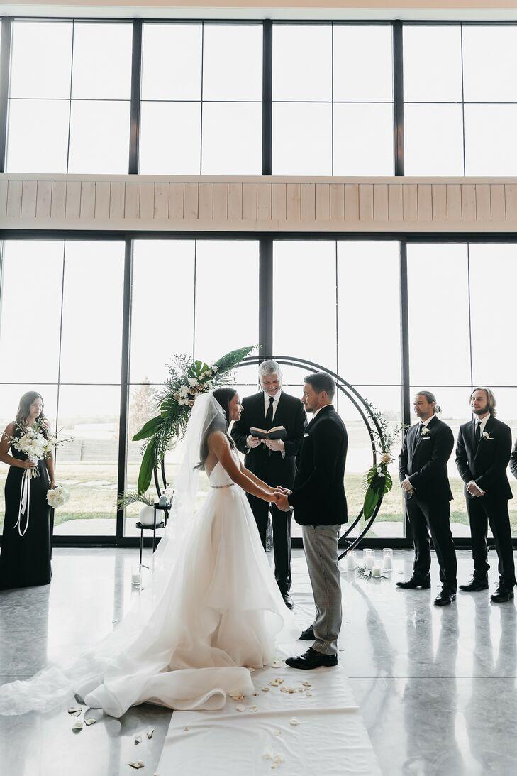 Modern Ceremony with Circular Wedding Arch and Windows