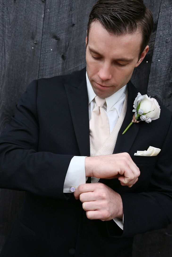 Mark wore a white collared shirt underneath a classic black tuxedo on the day of the wedding, along with a champagne-colored vest and tie. He had an ivory rose boutonniere pinned to his black jacket, which matched the pocket square that was neatly tucked into his pocket.