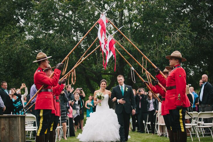 The couple walked underneath a saber arch held up by Canadian Mounties in full uniform.