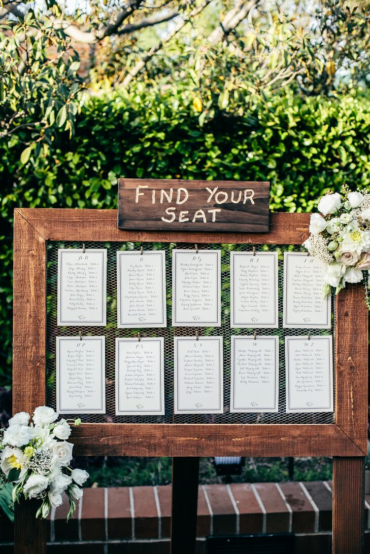Instead of escort cards, Cynthia and Andy helped guests find the way to their seats with a classic seating chart. To tie into the wedding's rustic theme, the seating assignments were displayed on chicken wire held in an antiqued wooden frame.