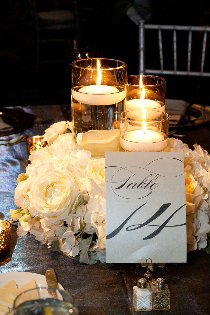 The low centerpieces included floating candles surrounded by flowers and the table number.