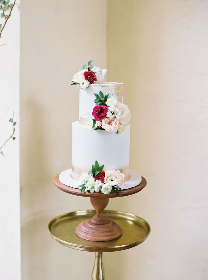 Gold-Brushed, Two-Tier Cake Adorned with Ranunculuses