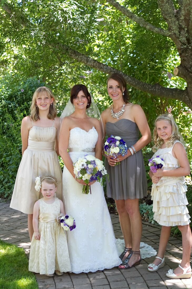 Jen chose a short gray J Crew dress with a sweetheart neckline for her maid of honor. The flower girls wore a mix of knee-length champagne colored dresses.