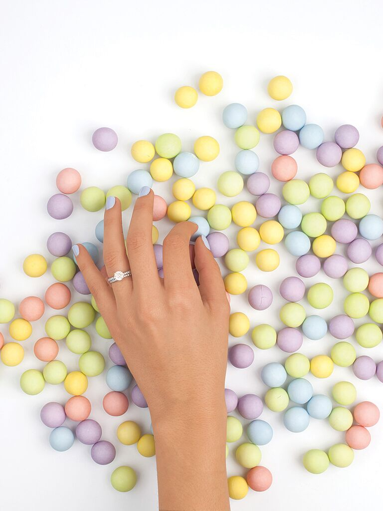 Engagement ring selfie idea with a fun candy background