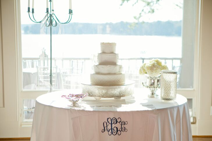 Timeless White Wedding Cake with Monogrammed Linen