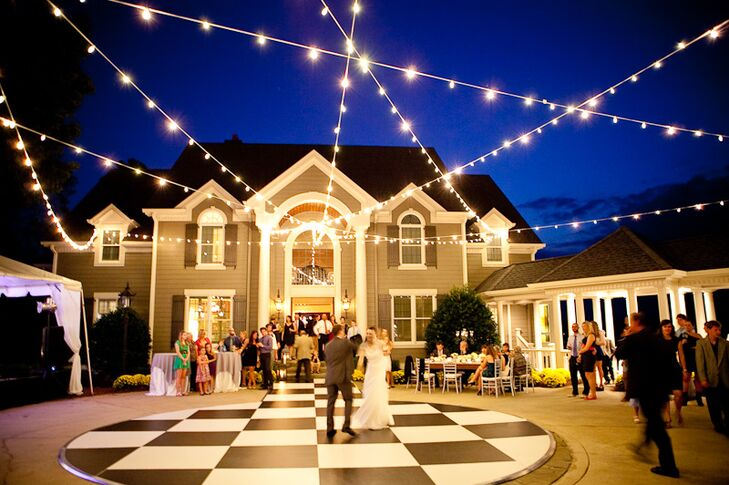 String lights hung from trees, illuminating the black and white checkered dance floor.
