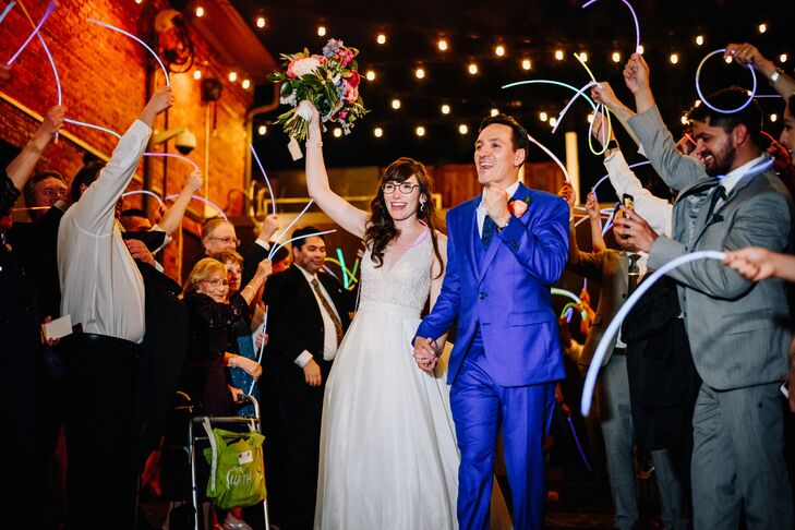 Modern Glow Stick Exit with Couple in Classic Gown and Bright Blue Suit