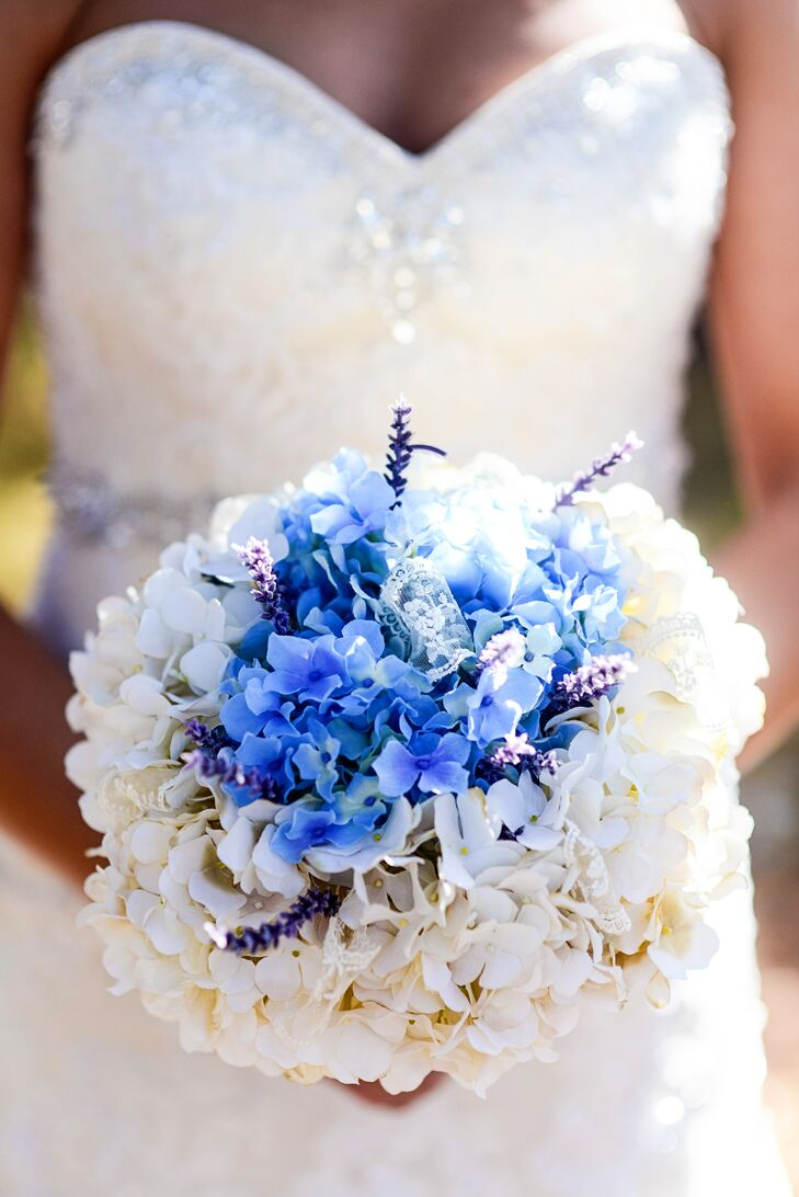 Jessica carried a bouquet of blue and white hydrangeas wrapped with her great-grandmother's handkerchief and lace and pinned with a brooch.