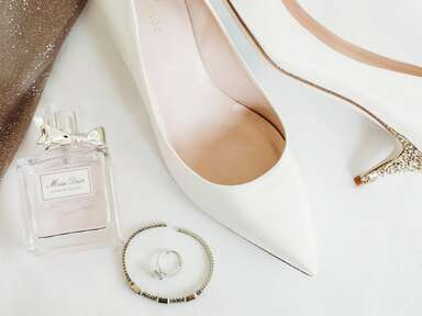 White wedding kitten heels with sparkly heel and perfume and wedding ring