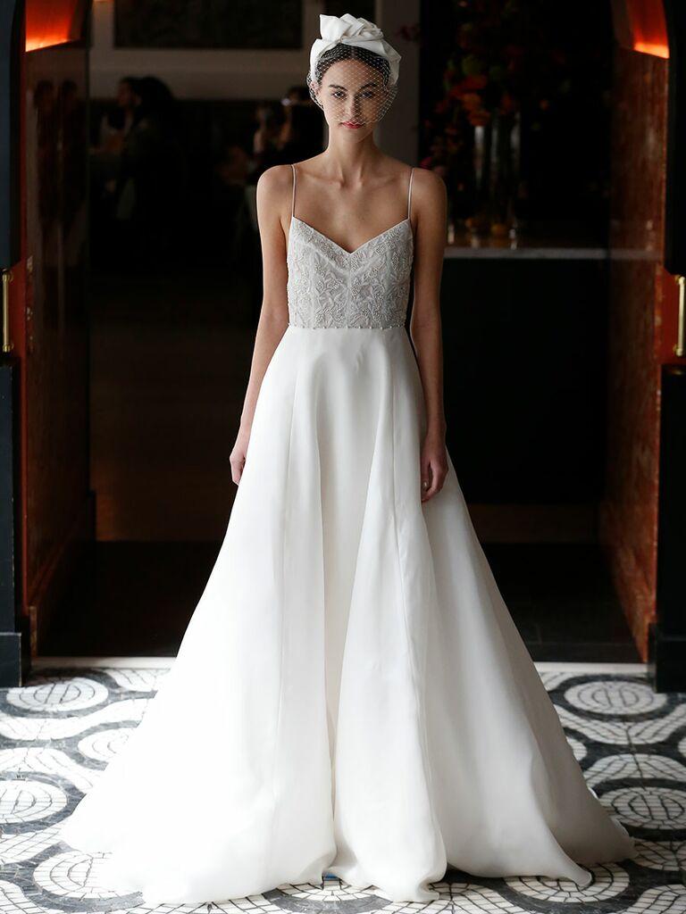 598335b06469 ... 3-D floral appliques on neckline. Lela Rose Spring 2018 spaghetti strap wedding  dress with embellished bodice