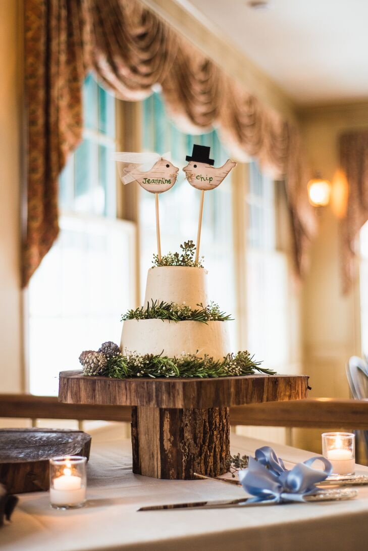 Jeannine and Chip enjoyed a personalized two-tier wedding cake from Wegmans in Rochester, New York. The cake was adorned with baby's breath, seeded eucalyptus and pine to match the winter theme. The two wooden love-bird cake toppers were made by Jeannine's mother.