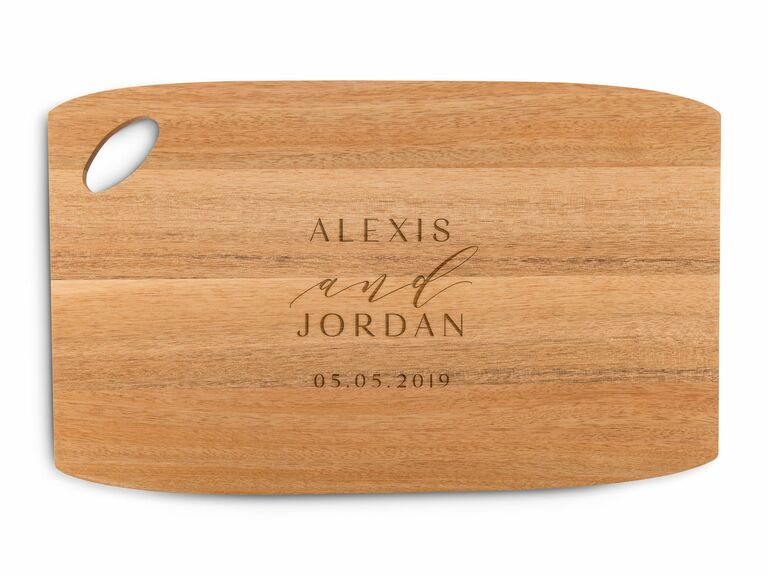 wooden cutting and serving board with oval handle
