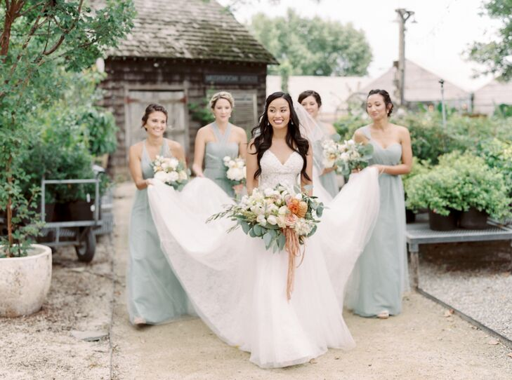 Bridesmaids in Sage Green Carrying the Brides Train
