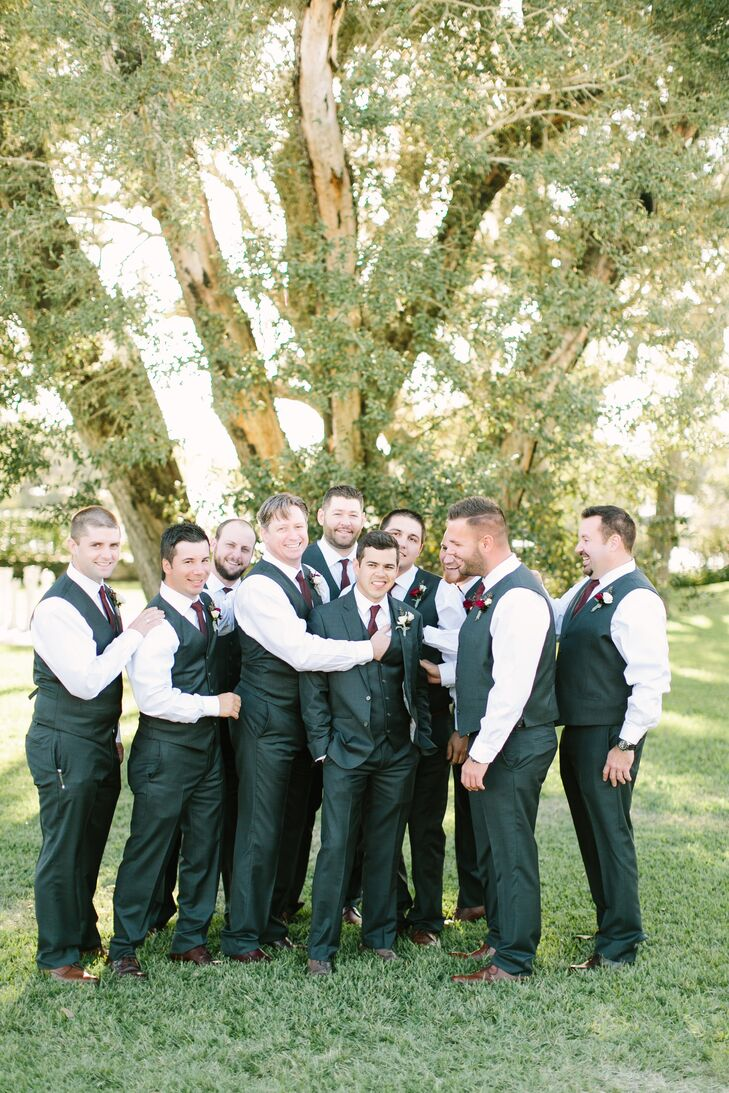 Nick and his nine groomsmen wore fitted gray suits with vests, fitted white button-down shirts and merlot ties with brown dress shoes.