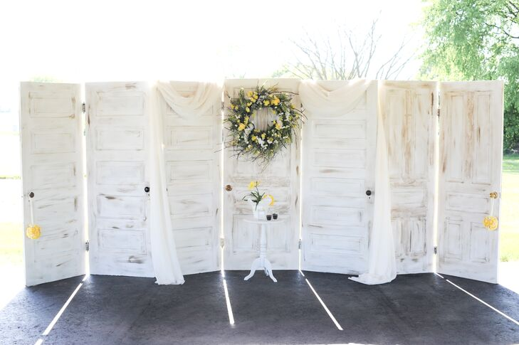 A row of white rustic doors stood behind the couple as they exchanged their vows.