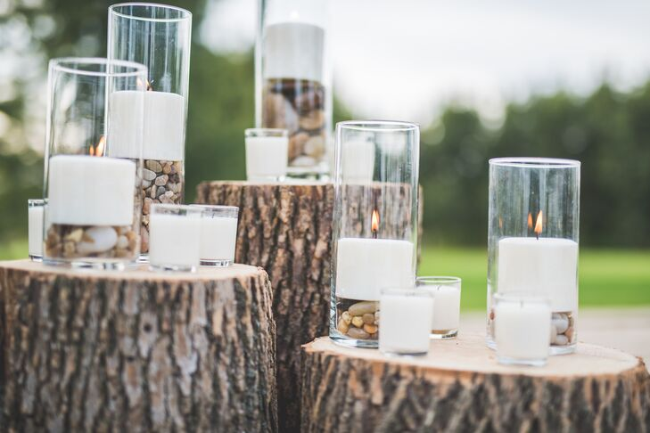 Cassie and Jason even included their style in the altar design for their ceremony at Arrowhead Golf Club in Wheaton, Illinois. They piled white candles in cylinder vases with river rocks. Each accent was then placed on a birch log. Now that's an authentic, rustic accent!