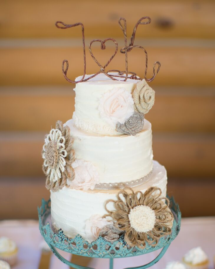 Two Sisters Bakery create this three-tier confection topped with rustic-inspired twine flowers.