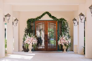 Burnt Pines Club House Door Framed With Garland and Pink Florals