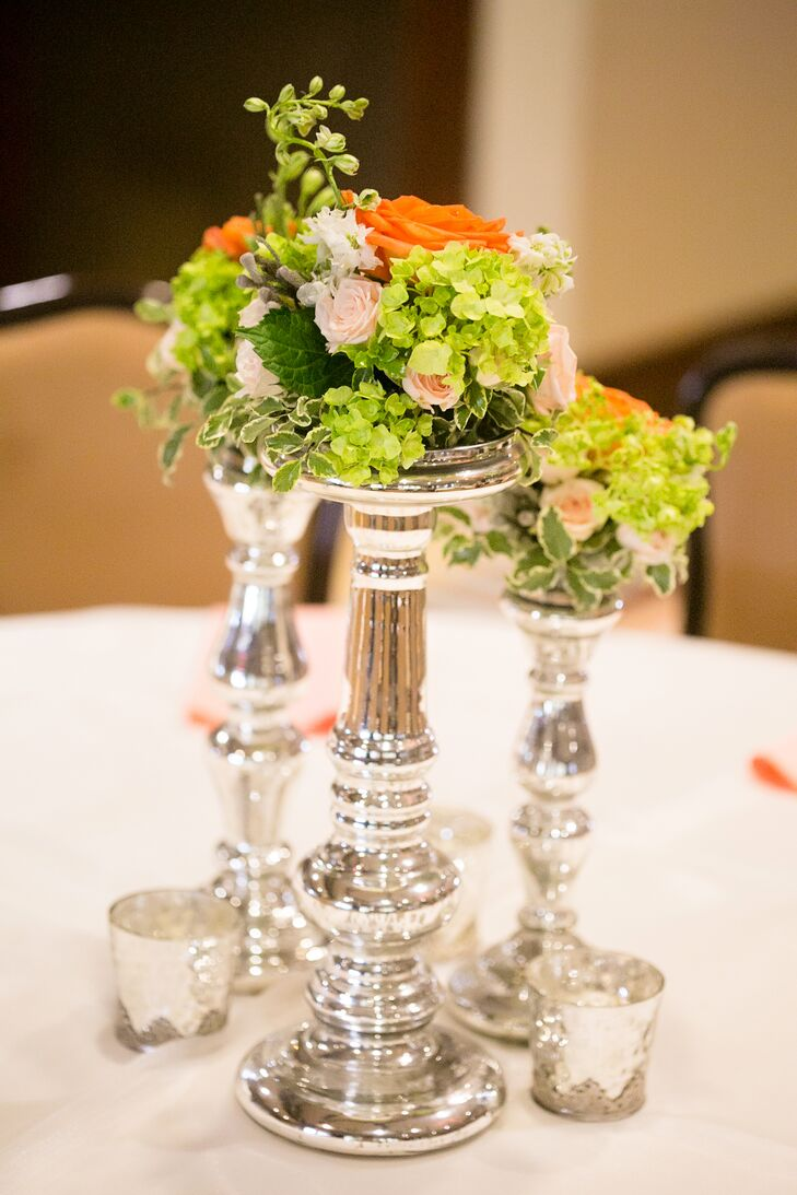 Silver metallic candelabras added a modern twist to Kaitlynn and Ty's classic reception at Ridgewood Country Club in Waco, Texas. Colorful flowers, including peach David Austin garden roses, green hydrangeas and coral roses, dotted each table.