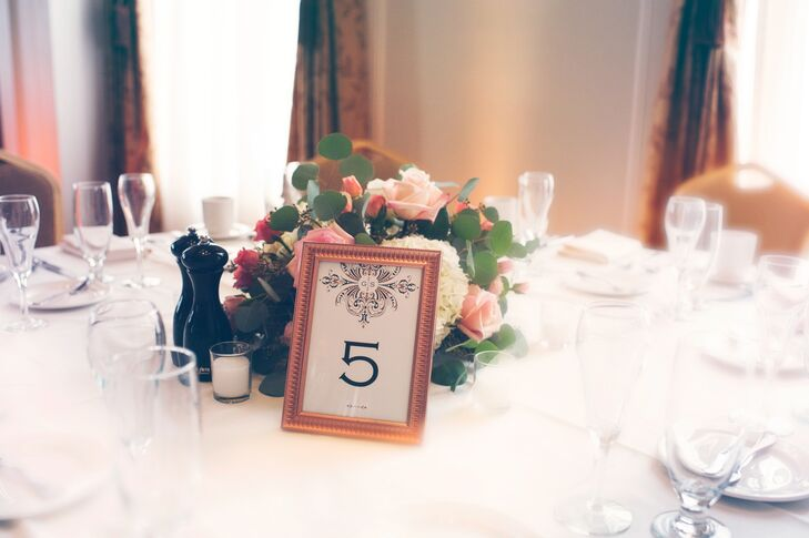 Echoing the escort cards, the table numbers were displayed in a frame with an art deco motif.