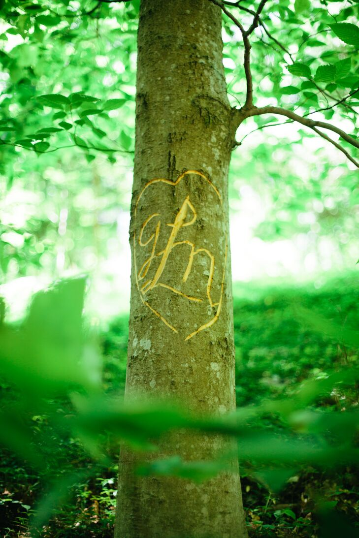 Gavin surprised his bride with a carving of their wedding monogram into a tree on the venue grounds.