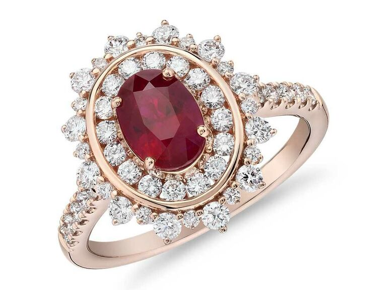 Oval ruby engagement ring with double diamond halo
