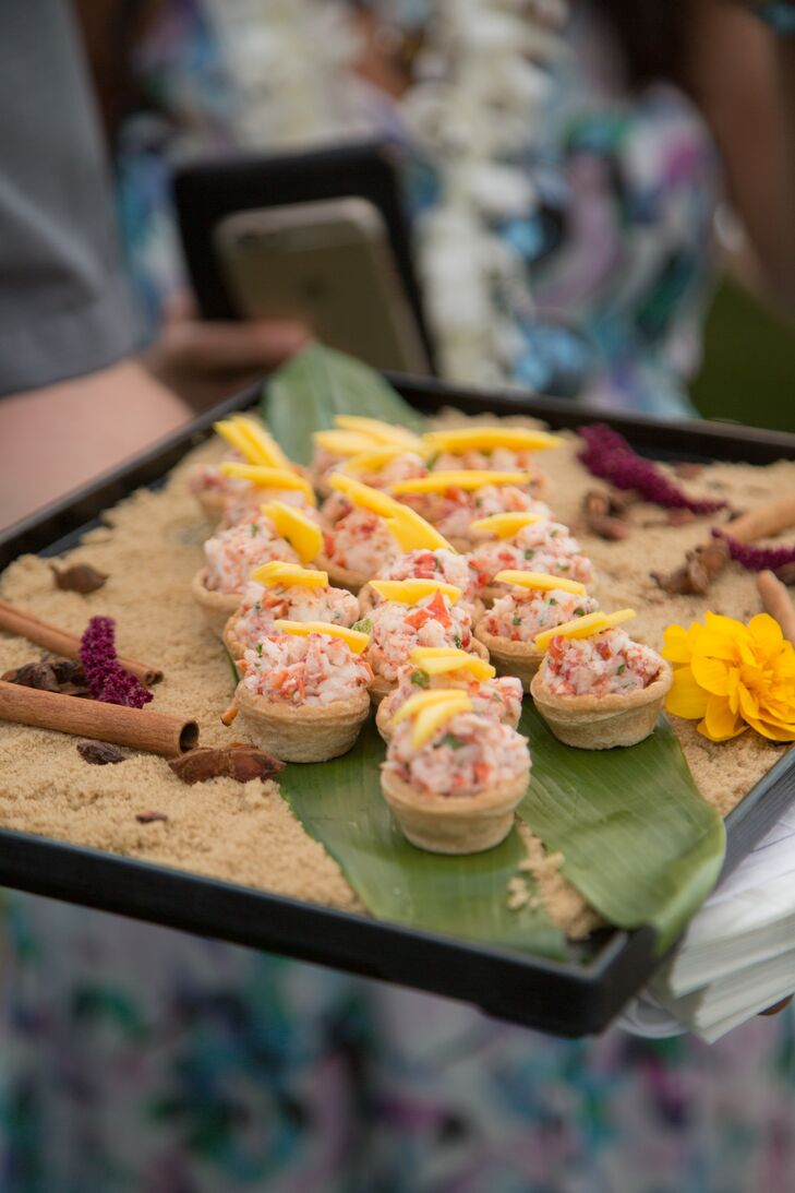 The Four Seasons Resort Maui in Wailea, Hawaii, provided local fare for the reception, including papaya and Hawaiian-style chicken.