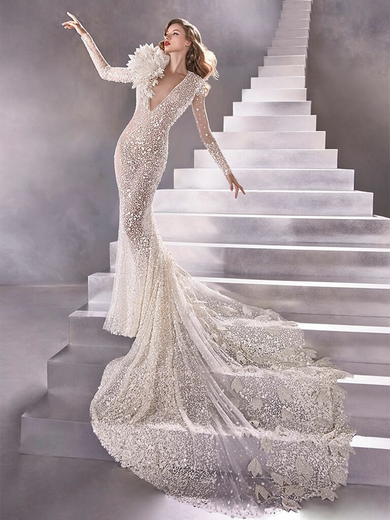 Atelier Provonias wedding dress sheer beaded mermaid gown with flower accessory