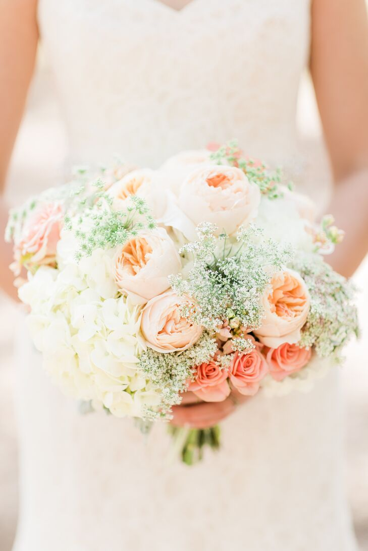 Karley's spring bouquet featured hydrangeas, roses and baby's breath in soft blush, peach and ivory hues.