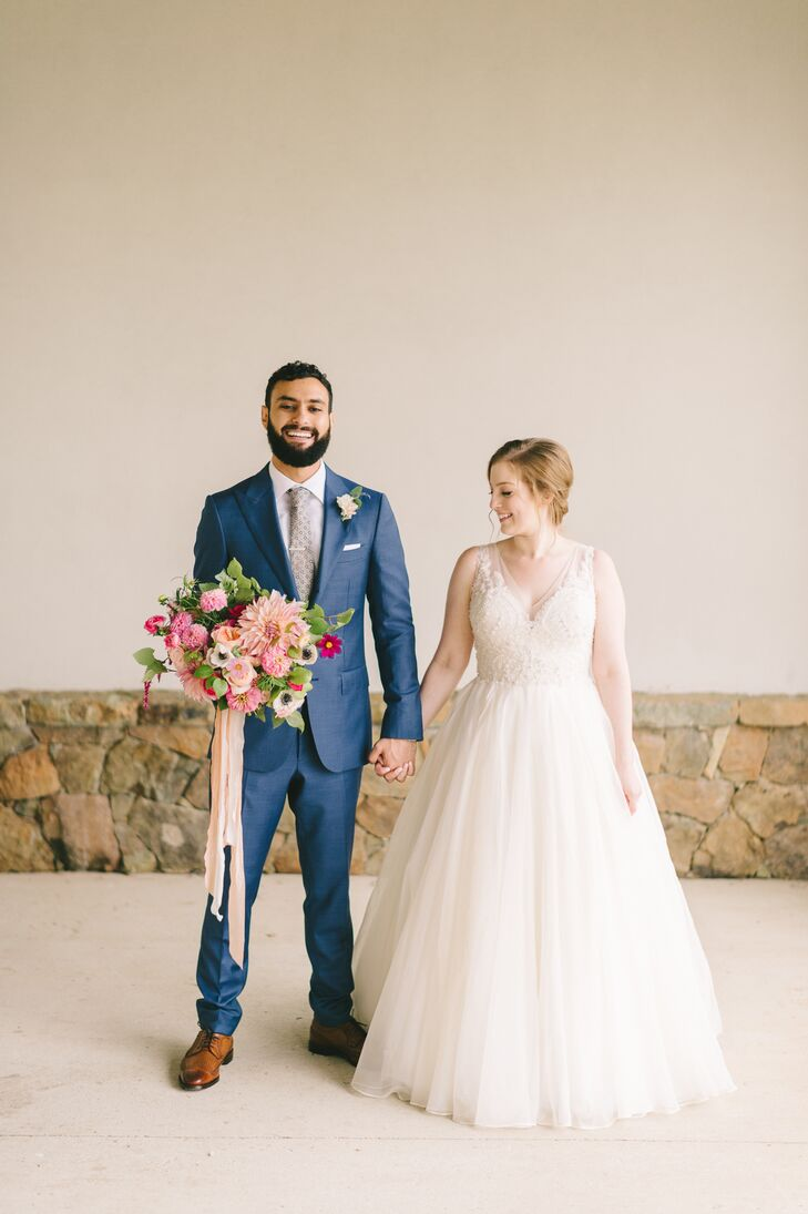 With romantic florals, natural touches and a punchy color palette of pink and gold, Taylor Sevin and Elias Saroufim pulled off an early fall wedding w