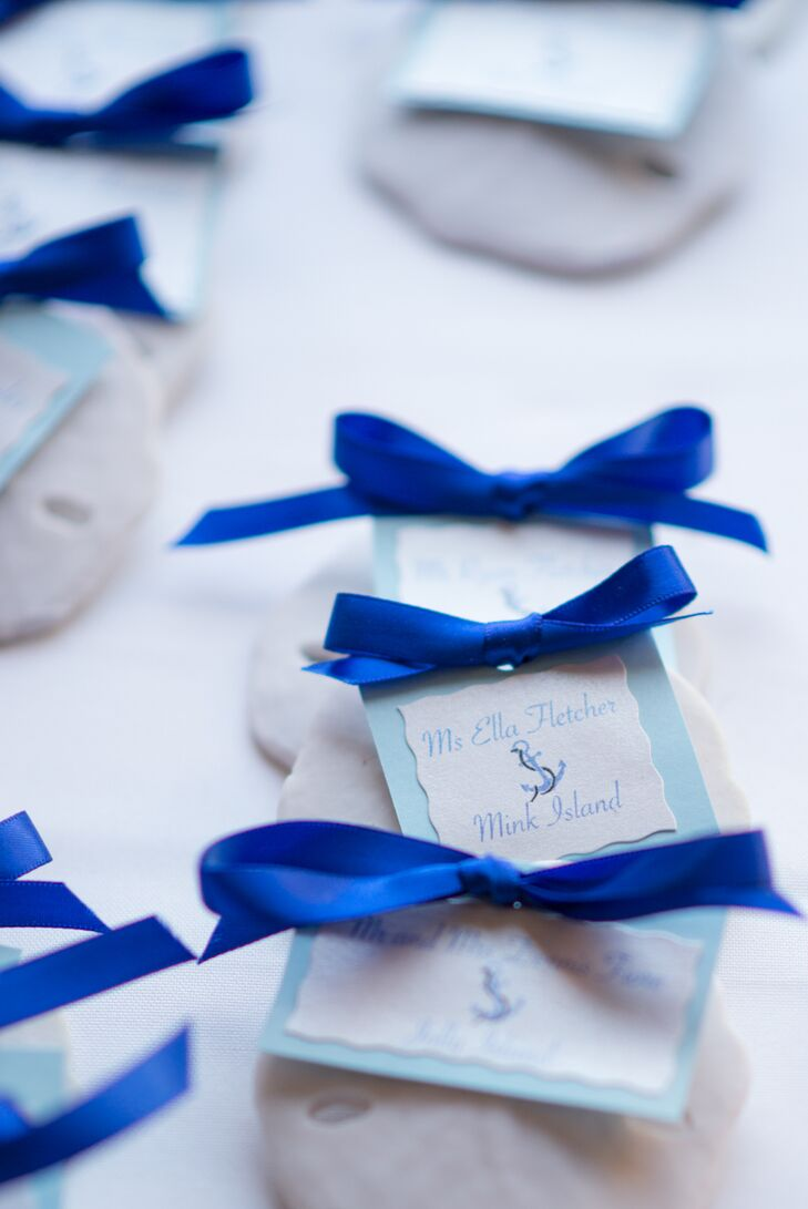 When it came to the design decisions, Katie and Steve took their wedding decor in a nautical direction. The couple and their children love to spend the summers on their boat on Lake Winnipesaukee in New Hampshire, so the theme was the perfect fit. Small details like handmade sand dollar escort cards touched on the theme and gave the decor a playful touch.