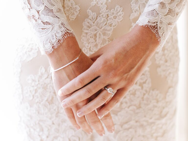 Superbe Bride With A Diamond Engagement Ring And A Lace Wedding Dress