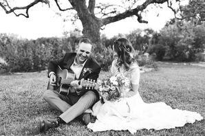 Groom Playing Guitar for Bride at Outdoor Elopement