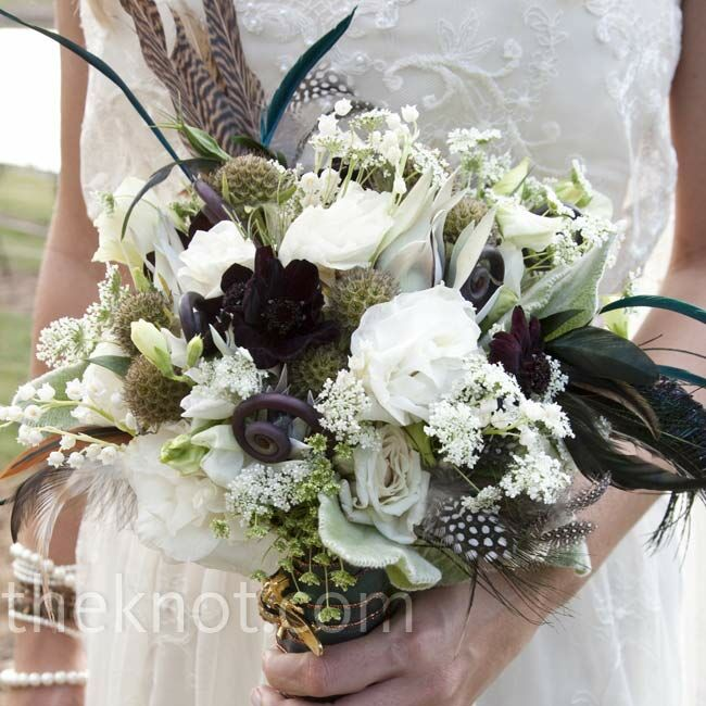 Erika carried an earthy mix of feathers, fiddlehead fern, chocolate cosmos, lisianthus and lily of the valley for a Bohemian-style bouquet.