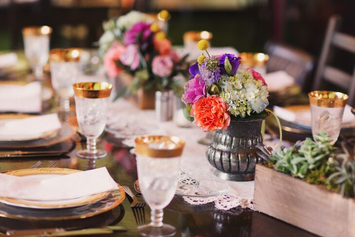 Annie fell in love with a picture of a super-bright bouquet and used it as the inspiration for their tablescapes. Each farm table was covered with colorful accents. This centerpiece alone had green-blue hydrangeas, purple roses, pink peonies, coral garden roses, yellow craspedia and purple delphiniums all inside a charcoal vase.