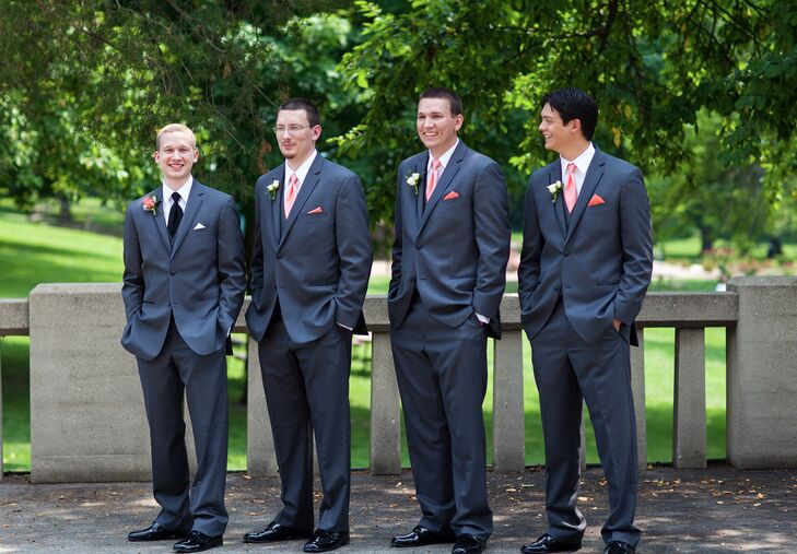 David and his groomsmen wore fitted gray tuxedos with coral ties to match the bridesmaid dresses.