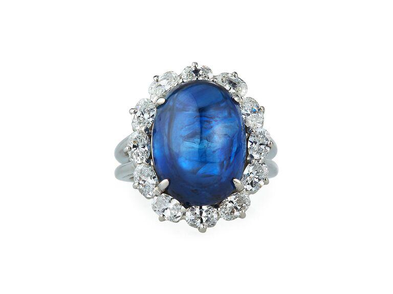 Blue sapphire engagement ring with diamond sunburst halo