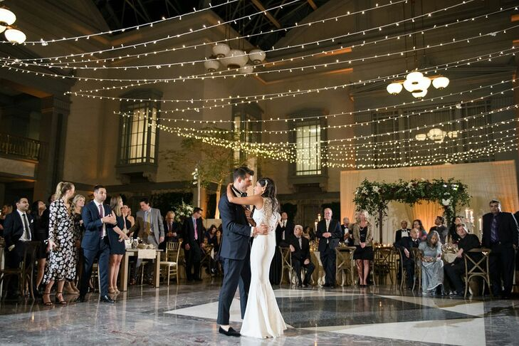 Elegant First Dance Beneath String Lights at the Harold Washington Library in Chicago, Illinois
