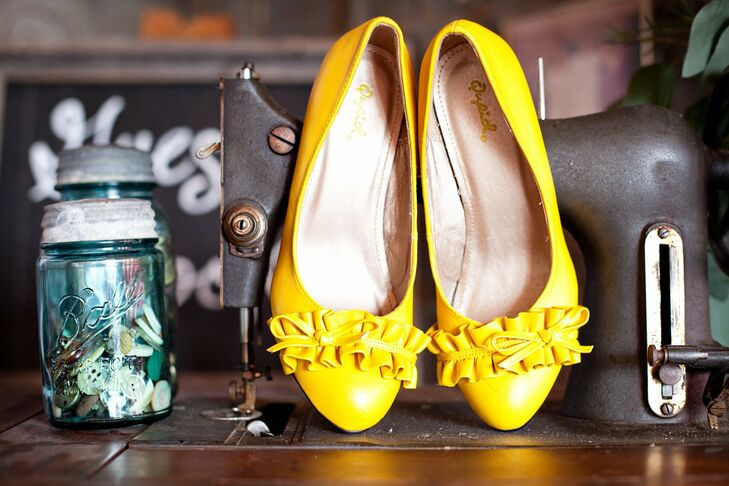 The bridesmaids wore different dresses in the same color with yellow flats.