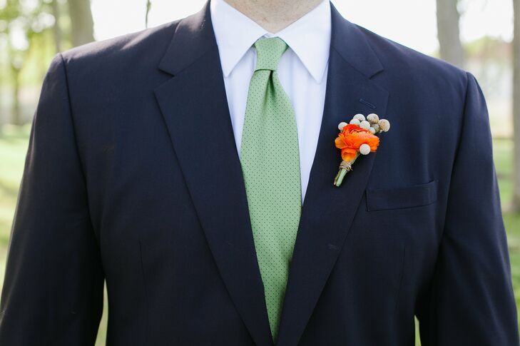 The men wore single orange ranunculus blooms, accented with silver brunia berries, on their lapels.