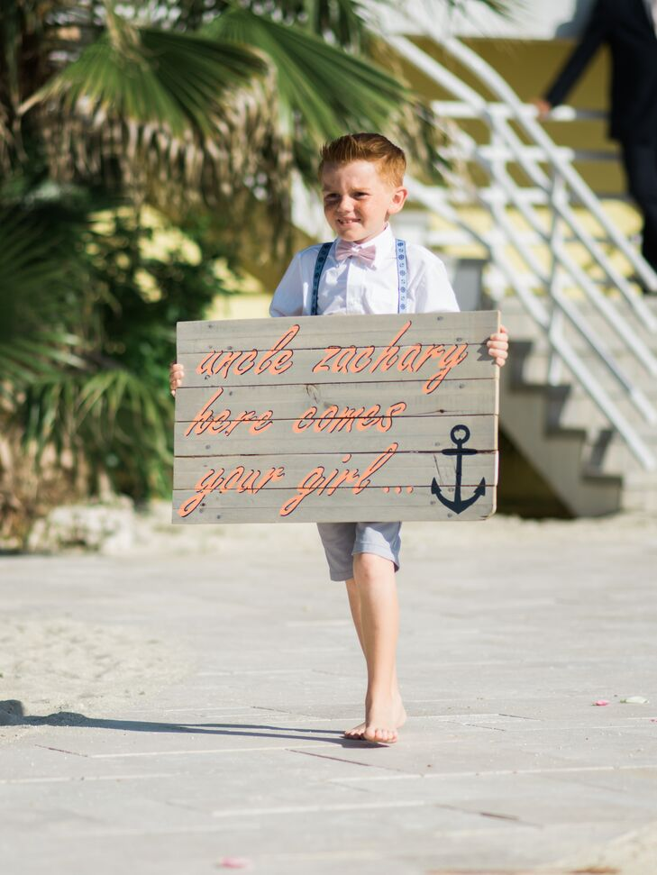 """""""My ring bearers wore light gray shorts with nautical suspenders and a bow tie, which matched the guys' ties. We were all barefoot, to keep the laid-back feeling,"""" Nicole says."""