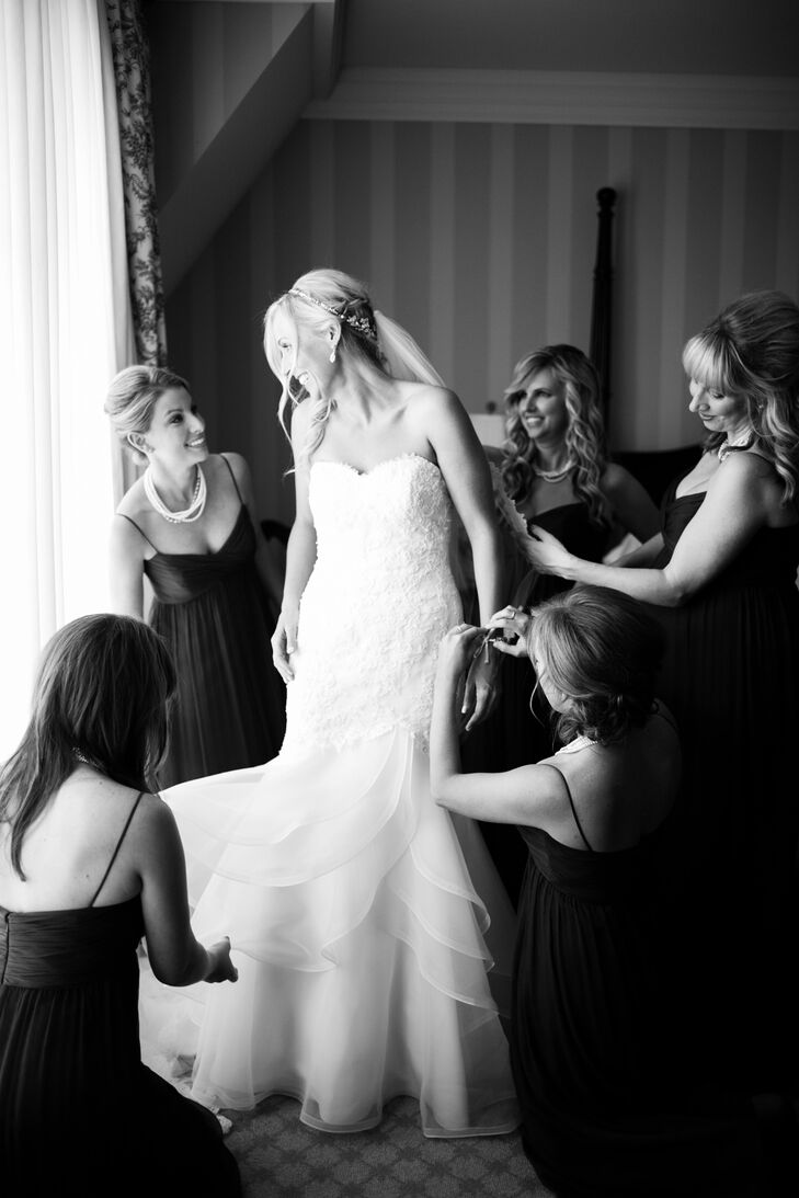 The bridesmaids wore dark gray spaghetti strap dresses so that their bright pink bouquets would have a neutral background for contrast. Since her sister was four months pregnant at the time, she wanted to make sure she found a dress that all of her bridesmaids would feel comfortable in.