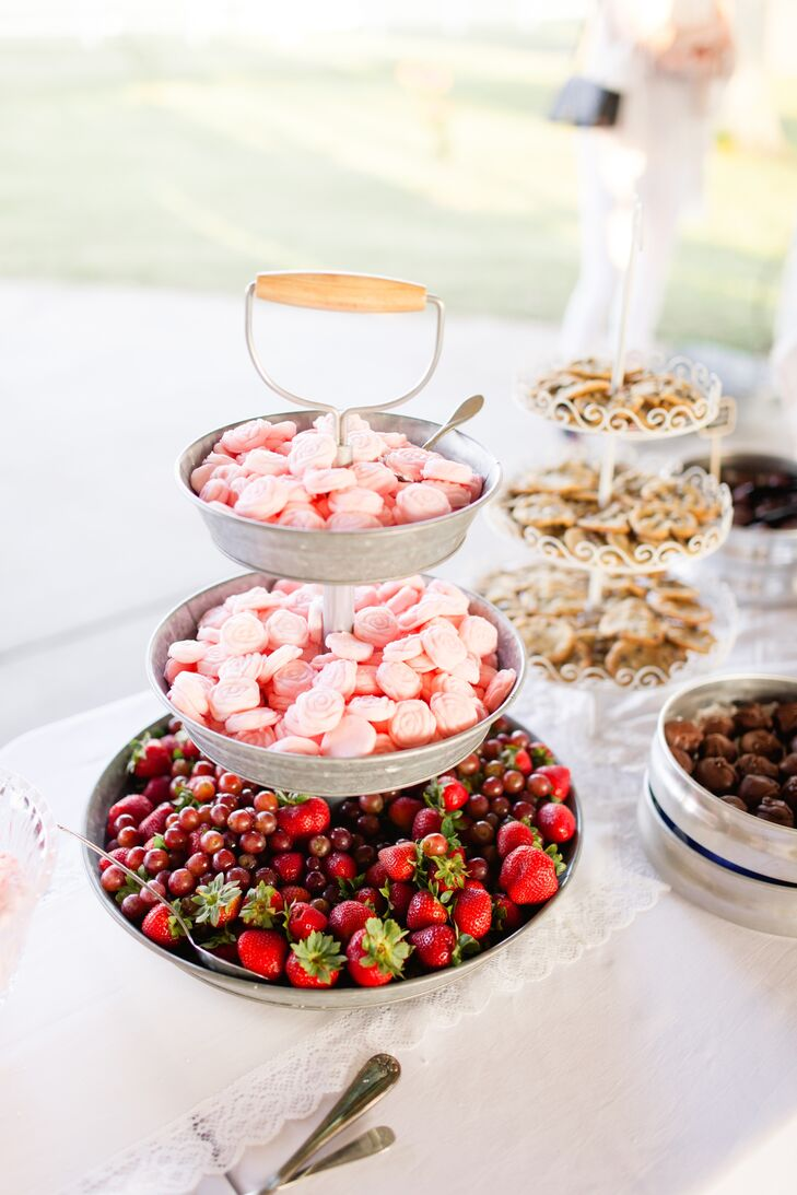 Alix and George decided to skip tradition when it came to the wedding cake, passing on the classic confection and opting instead for a spread of sweet treats. Assorted cookies, mini bundt cakes, fruit and sand tarts and fresh fruit dotted the display, inviting guests to sample a selection of the tasty tidbits.