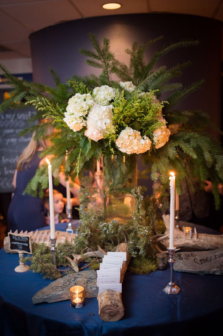 Each guest found his or her simple white escort card within a wooden log to complement the forest-inspired theme.