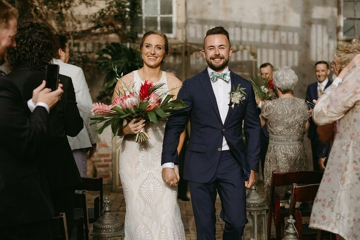 Modern, Bohemian Couple with Navy Suit, Halter Wedding Dress and Tropical Bouquet
