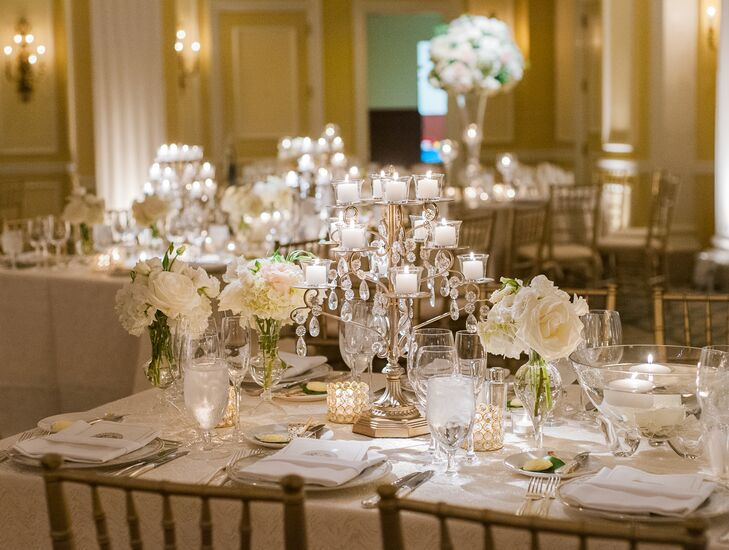 Crystal candelabras on the reception tables cast a warm glow throughout the space.